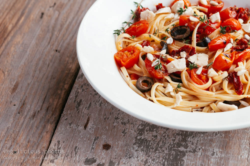 Stock photo of Tagliatelle With Roasted Cherry Tomatoes and Olives