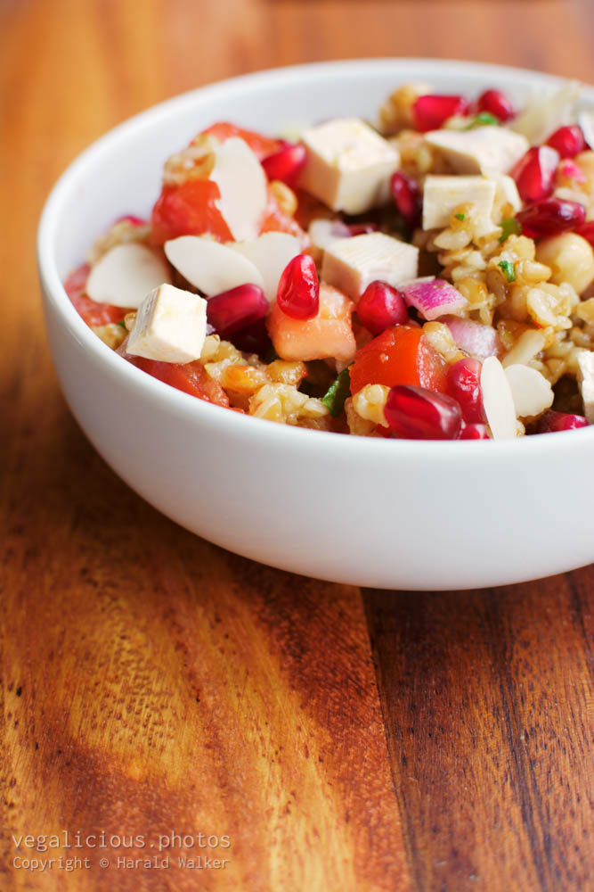 Stock photo of Bulgur Tomato Salad with Pomegranate Arils Mint and Almonds