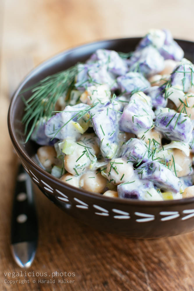 Stock photo of Purple potato salad with chickpeas and dill