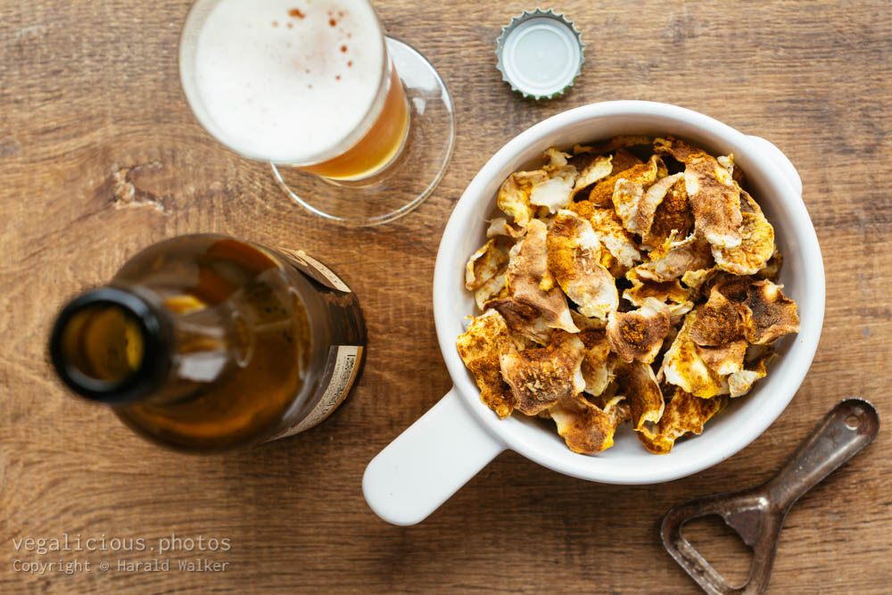 Stock photo of Turnip chips and beer
