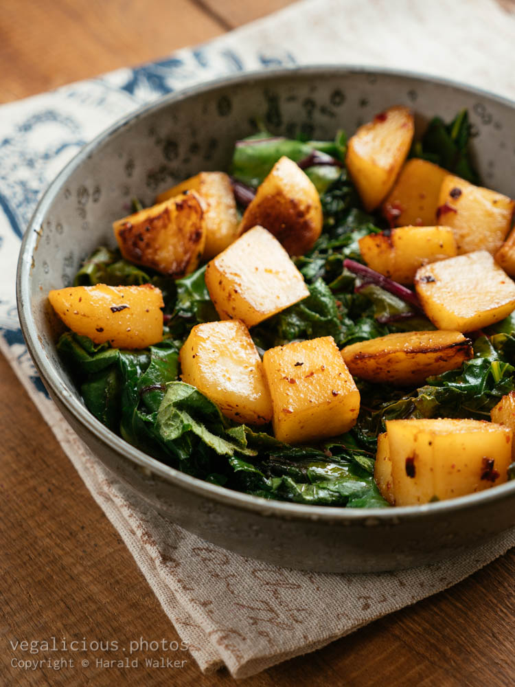 Stock photo of Roasted turnips with sauteed cabbage greens