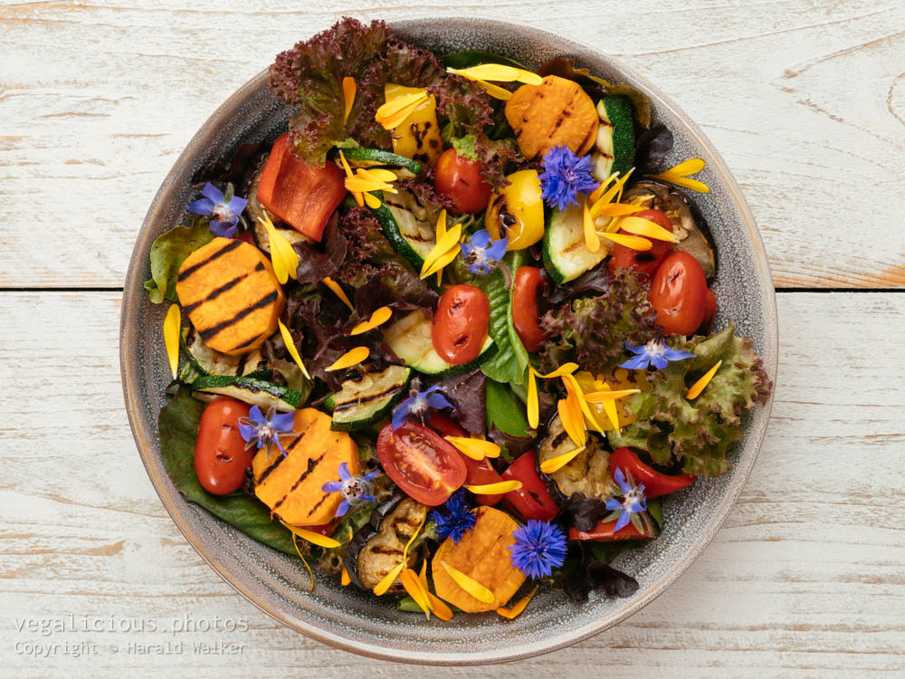 Stock photo of Mixed Green Salad with Grilled Veggetables and Edible Flowers