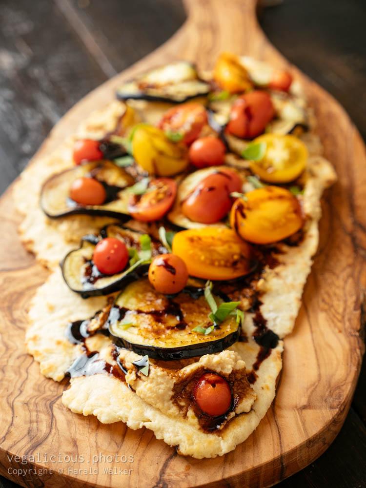Stock photo of Flatbread with Hummus, Eggplant and Tomatoes