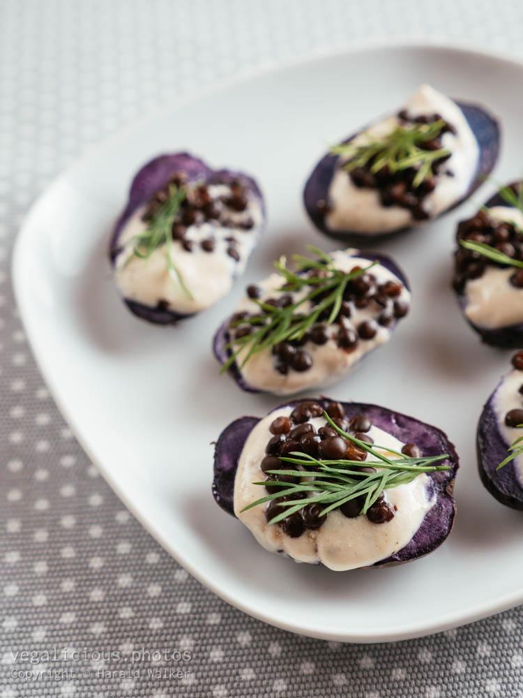 Stock photo of Purple Potatoes with Vegan Feta Spread and Beluga Lentils