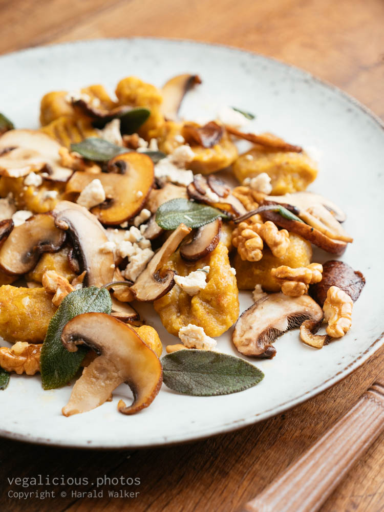 Stock photo of Pumpkin Gnocchi with Mushrooms and Walnuts, Sage Buttered Sauce
