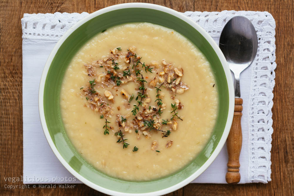 Stock photo of Apple Parsnip Soup with Thyme Walnut Garnish