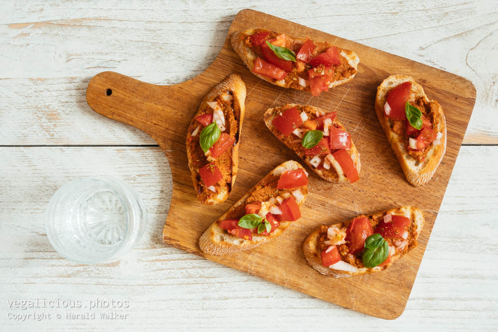 Stock photo of Bruschetta with Muhammara Spread and Chopped Tomatoes