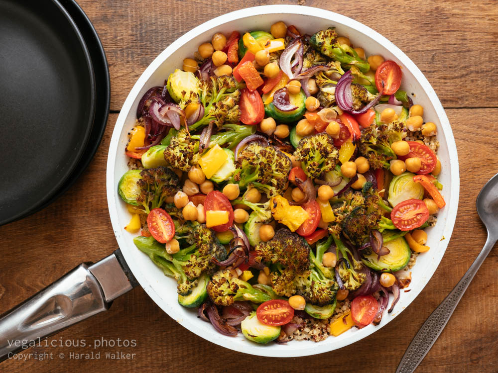Stock photo of Roasted Purple Sprouting Broccoli, Brussels Sprouts and Peppers on Quinoa