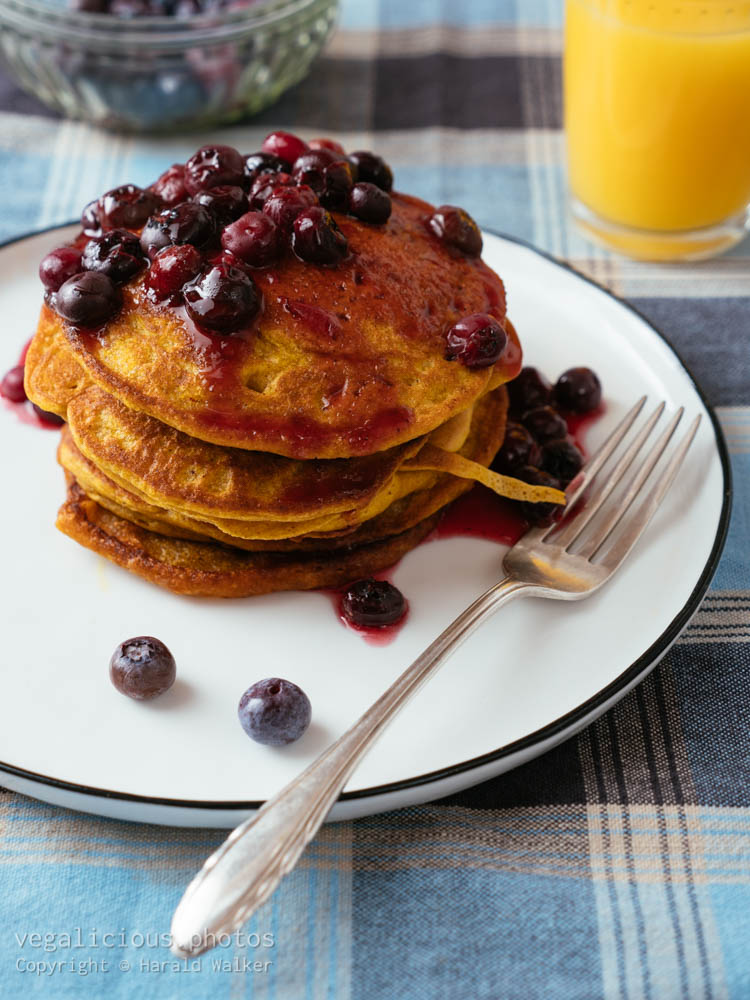 Stock photo of Pumpkin Pancakes with Blueberry Sauce