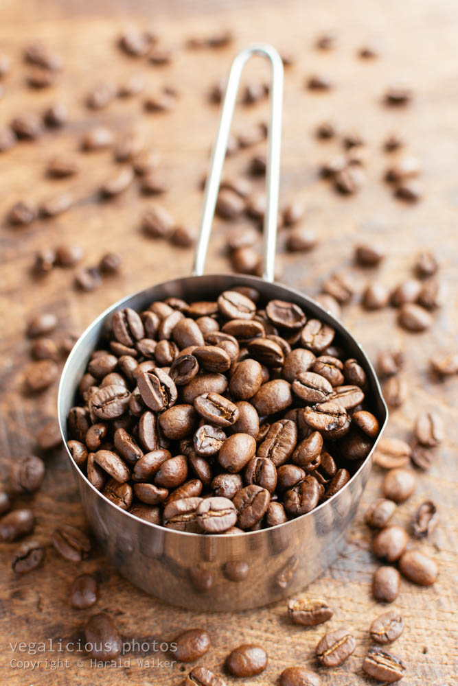 Stock photo of Measuring cup of coffee beans