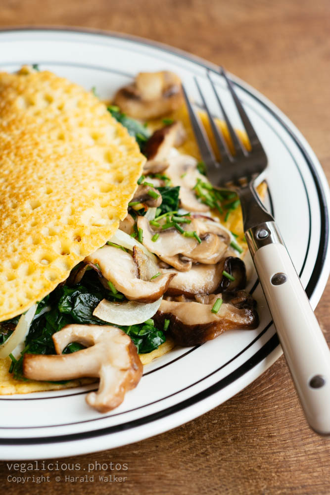 Stock photo of Creamy mushroom and spinach crepes