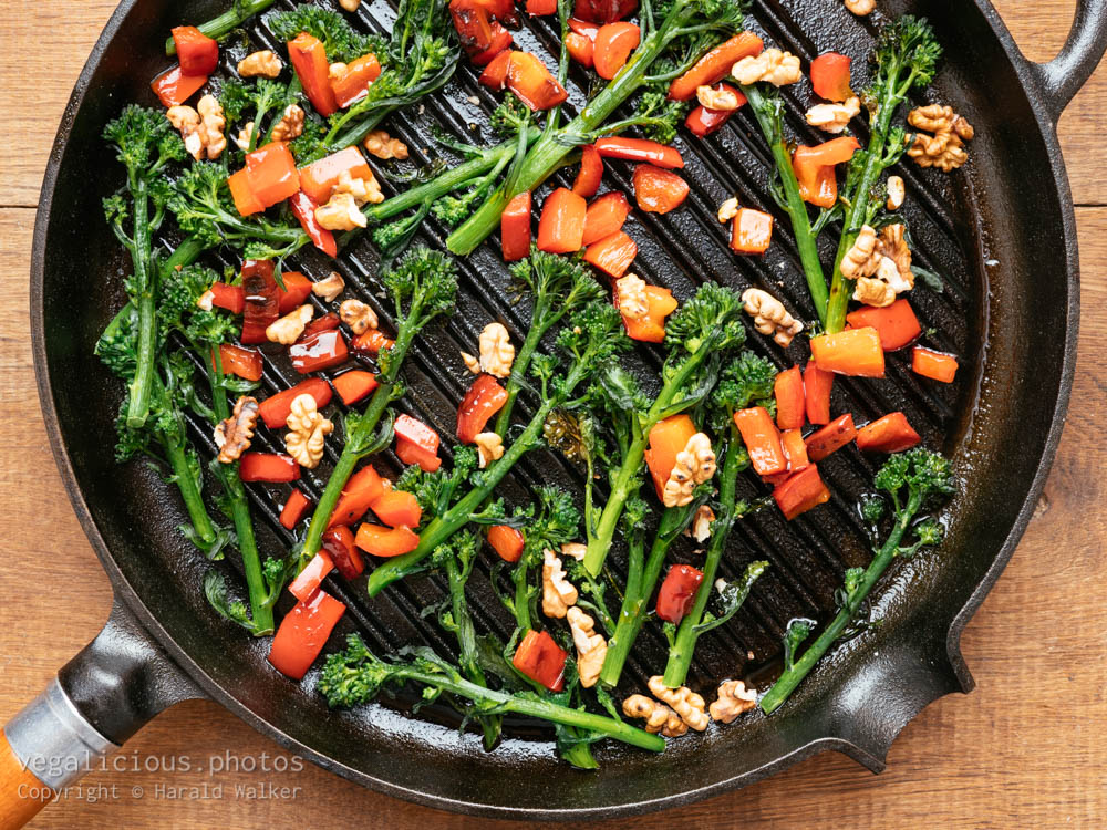 Stock photo of Grilled Sprouting Broccoli with Red Bell Peppers and Walnuts
