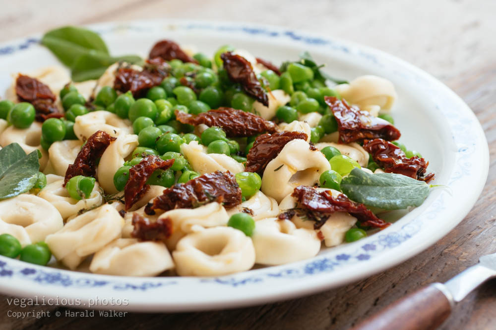 Stock photo of Tortellini with Fresh Garden Peas and Sun-dried Tomatoes