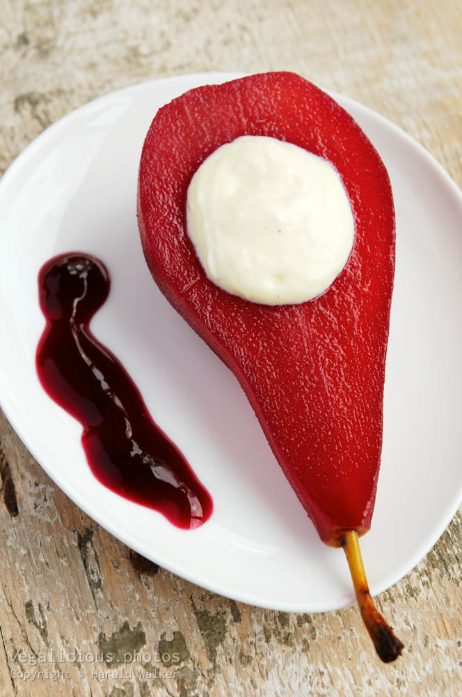 Stock photo of Red wine poached pears with vanilla bean mascarpone filling