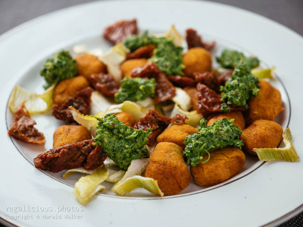 Stock photo of Winter Squash Gnocchi with Roasted Fennel and Spinach Pesto
