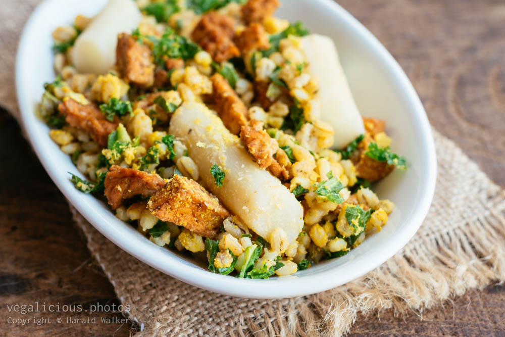 Stock photo of Salsify with Pearl Barley, Kale and Spicy Tofu Pieces