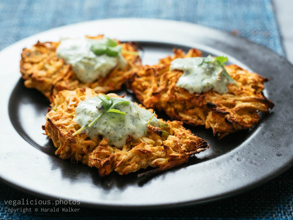 Stock photo of Parsnip, Carrot Fritters with Yogurt Zhoug Sauce