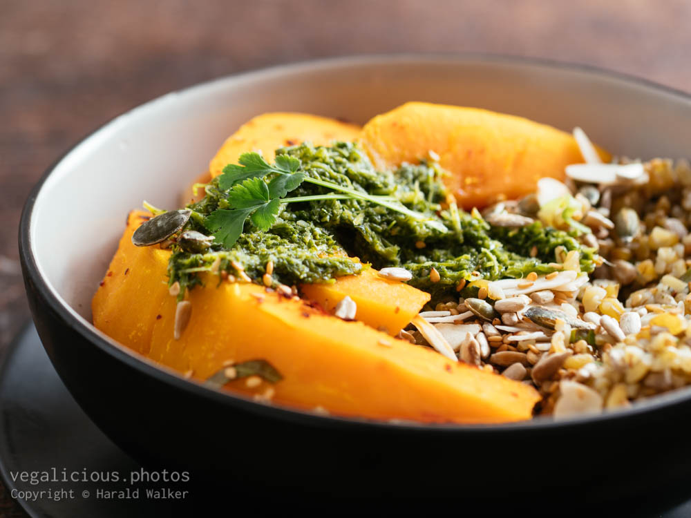 Stock photo of Roasted Squash, Seeded Herbed Freekeh and Zhoug