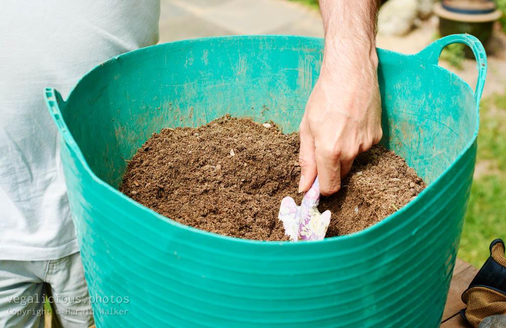 Stock photo of Mixing soil