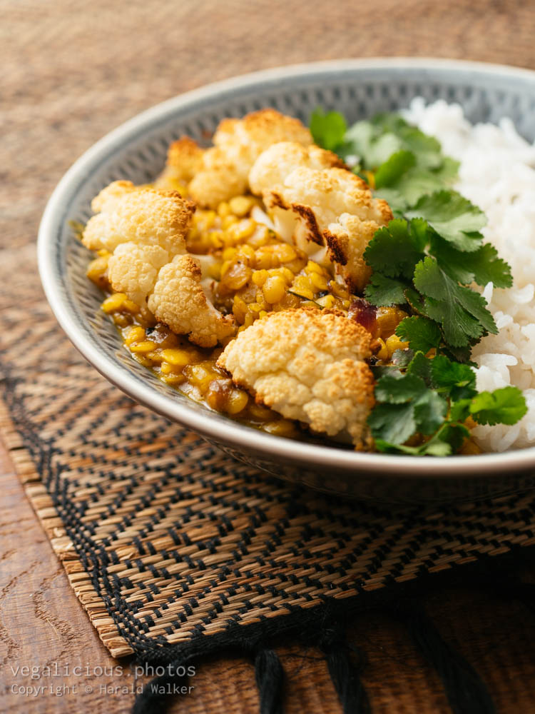 Stock photo of Roasted cauliflower with curried Lentils and Rice