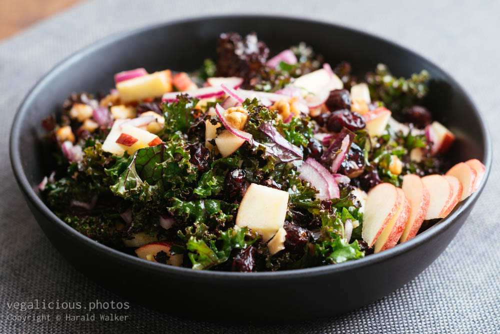 Stock photo of Kale Salad with Apples, Walnuts, Cranberries and Red Onions