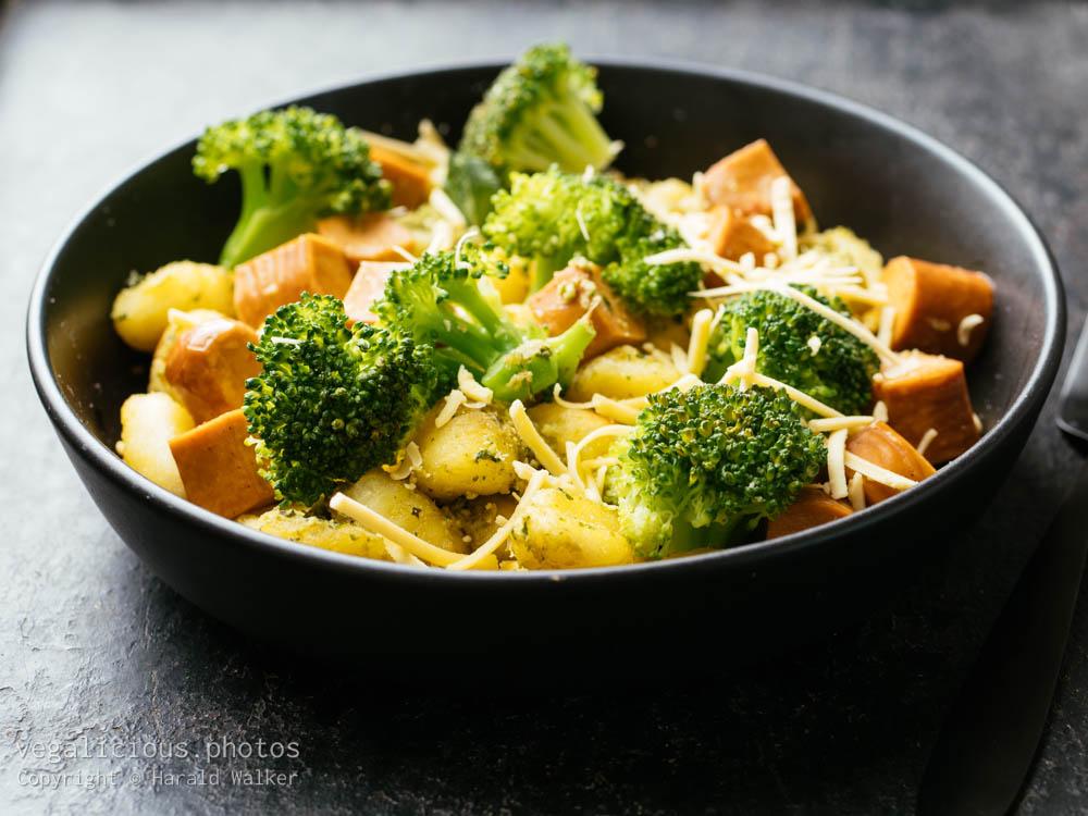 Stock photo of Gnocchi with Broccoli, Broccoli Stem & Basil Pesto and Vegan sausages