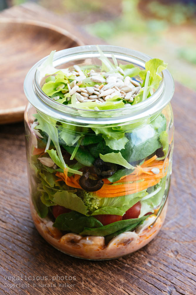 Stock photo of Mixed salad in a jar