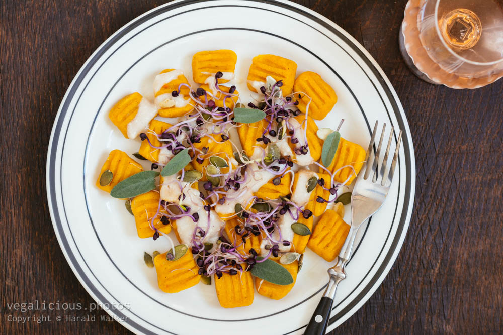 Stock photo of Winter Squash Gnocchi with Garlicy Sauce, Sprouts and Pumpkin Seeds