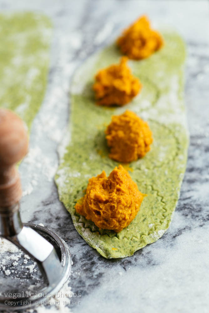 Stock photo of Making winter squash filled spinach ravioli