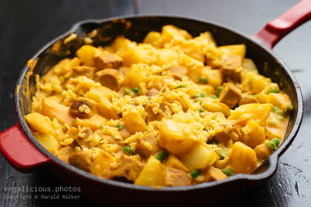 Stock photo of Vegan Hot Dog, Potato, Pea Dinner with Cheesy Sauce