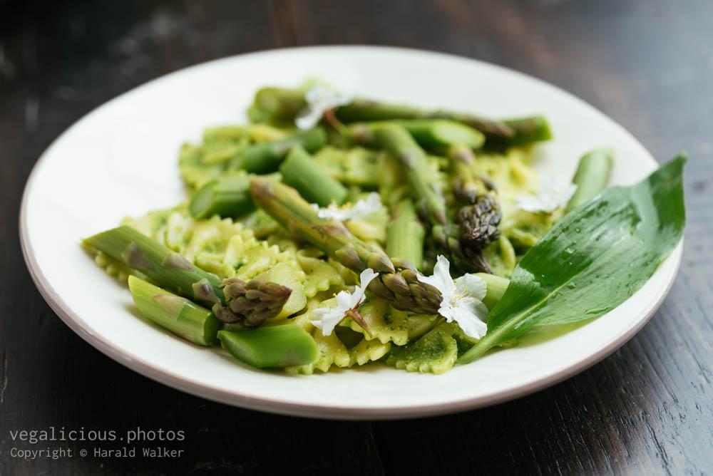 Stock photo of Wild Garlic Pesto on Bow tie Pasta with Fresh Asparagus