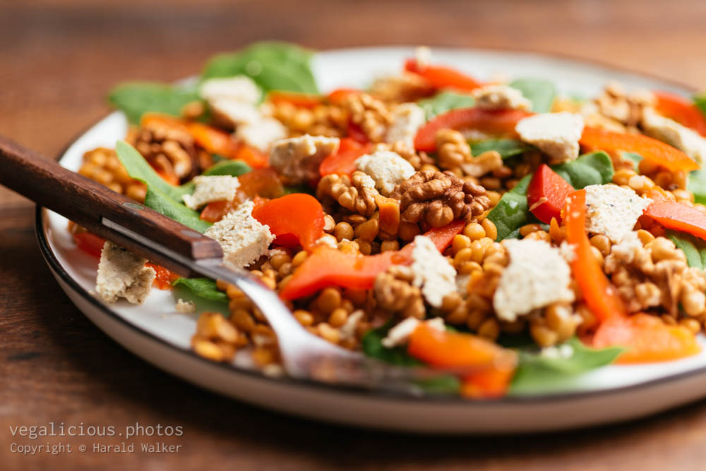 Stock photo of Spinach and Lentil Salad with Roasted Peppers, Walnuts and Vegan Feta